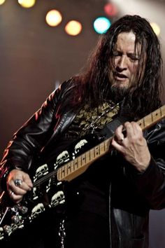 """Michael F. Wilton (born February 23, 1962)[1] also known as The Whip, for how fast his fingers """"whip"""" around the guitar fretboard,[2] is an American guitarist for the progressive metal band Queensrÿche, which he co-founded in 1982."""