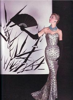 Model wearing a Balmain silver and black leopard gown in the 1950s.
