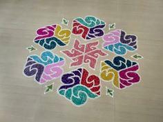 Margazhi kolam designs with dots and colours. Beautiful sangu kolam designs with 19 x 10 interlaced dots.
