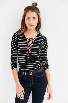 If you're more of a basics kind of gal, try this black + white striped long sleeve tee as a new layering go-to piece.