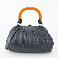 Tortoise Shell Top Handle Bag, $57, now featured on Fab.
