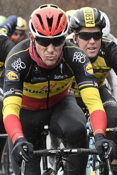Belgium's Philippe Gilbert (C) rides in the rain during the 195 km second stage of the 75th edition of the Paris-Nice cycling race, between Rochefort-en-Yvelines and Amilly, on March 6, 2017. / AFP PHOTO / Philippe LOPEZ