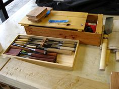 Japanese Toolbox. This fine example has a shelf tray system for chisels on the top level. The tray is finely crafted with box joints and foot boxes for the chisels.