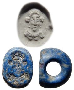 Lapis Sasanian seal with bearded king or hero, 3rd-5th century A.D. Wearing a elaborate headdress, earrings and a necklace, 1.7 cm long. Private collection
