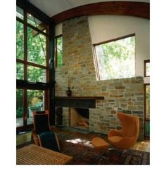 Ozark stone and slate with curved wood beams  Rod Collins Construction, Little Rock architect and custom home builder