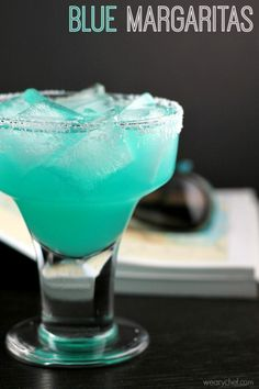 Blue Margarita Recipe - A fun twist on a classic cocktail! - wearychef.com (scheduled via http://www.tailwindapp.com?utm_source=pinterest&utm_medium=twpin&utm_content=post881015&utm_campaign=scheduler_attribution)