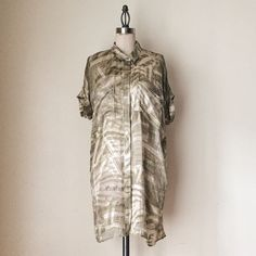 "UO | Oversized Taupe Sheer Silk Top FEATURES:  *Oversized fit  *Short sleeves  *Collar  *Hidden buttons down front  *2 breast pockets  *Slightly sheer  *Tunic length  *50% silk 50% rayon   MEASUREMENTS: Bust - 44"" Waist - 43"" Length - 34 1/2""  ✅ Very good condition ⛔️ NO SWAPS/TRADES/RESERVES Urban Outfitters Tops Blouses"