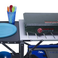 Portable folding cook station brings the kitchen outside with counter and storage space for a camping stove or grill, cooking utensils, and cookware Camping Table, Camping Stove, Camping Meals, Wire Storage Racks, Garbage Bag Holder, Desk With Keyboard Tray, Grill Station, Paper Towel Holder, Glass Holders