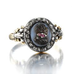 An Antique 'Blackamoor' Cameo Ring, with Ruby Collar Accents, Within a Rose-Cut Diamond Frame, circa 1820. Available Exclusively at FD. www.fd-inspired.com