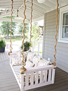 HGTV is presenting a variety of garden swings in backyards, on porches and for waterfront settings.