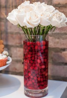 Use cranberries to elevate a simple bouquet of roses into a magical holiday centerpiece