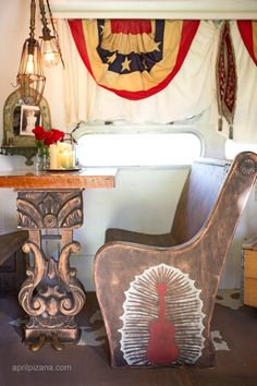 {dreamers lovers & troubadours » Photography by April Pizana} - a CHURCH pew turned booth in DIerks Bentley's airstream! ANDDDD . . . a center pedal from a GRAND PIANO as the table leg . . upcycled grandeur!