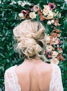 Gorgeous low messy up-do wedding hairstyle.