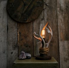 """This is one of my personal favorites. I wanted to make a light that had the"""" log cabin"""" feel with a little bit of an industrial side to it. I have securely attached REAL antler sheds to a steel pipe base and have wrapped them in a .25in Manila rope. I love how every side of this light has its own cool look because of the unpaired antlers that I used"""