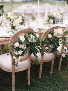 Greenery covered wedding chairs: Photography: Lisa Ziesing for Abby Jiu - http://www.abbyjiu.com/