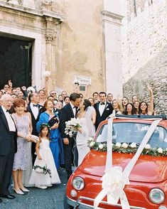 "This Classic Wedding in Italy Began With An Unforgettable Entrance | Martha Stewart Weddings - After the Catholic ceremony, on June 12, 2015, the party paraded back through Taormina's streets to Belmond Grand Hotel Timeo for cocktails on the balcony. An alfresco dinner followed, plus a surprise when it was time for the wedding cake. ""It was enormous!"" says Talia of the unexpectedly giant vanilla and strawberry creation. ""And delicious."" La dolce vita indeed."