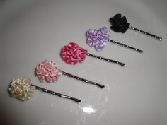 "These small but gorgeous flowers are perfect for everything from special occasion updos for weddings (flower girls, bridal parties) to an everyday splash of sassy color in your little girl's hair!! Each rose measures approximately 1/2"" across and is mounted onto a bobby pin.     Each single rose comes standard on a bobby pin, but is also available, by request, on a headband, brooch pin or alligator clip and is also available in a cluster!     Set of 2 for only $5.00!!"