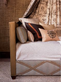 Love this nailhead pattern  masculine bedroom idea- ***COULD DO THIS TO BOX SPRING TO DECORATE IT UP ***