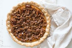 Holiday sweet potato pie with a pecan topping. Dense and sweet filling with sweet potatoes, sweetened condensed milk, cinnamon, nutmeg, ginger, vanilla, and bourbon. Topped with candied pecan topping. Perfect for #Thanksgiving Delicious! On SimplyRecipes.com