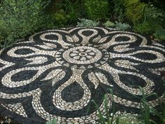 Mandala backyard patio project    Custom designed patio for a sunny spot in the garden. Patio is 11 feet in diameter, large enough for a table and 6 chairs. Photo by Marianne Kaplan of Pebble and Co. Mosaics