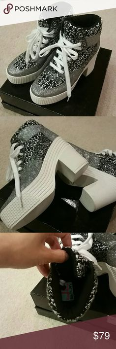 """Brand new Jeffrey Campbell silver & black platform Super Cool!!! Brand new JC Play by Jeffrey Campbell silver and black platforms. Size 9, but runs a little small so best for 8.5. Heel is 4"""" platform is 2.5"""". Black/white/silver woven fabric throughout and silver glitter accents all over. New without tags. No PayPal or trades. Jeffrey Campbell Shoes"""