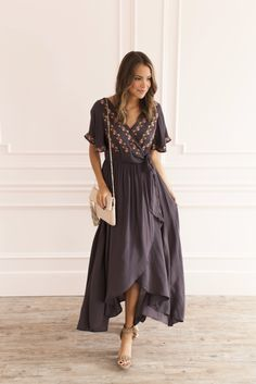 The Deja Embroidered Wrap Dress is made for walks on the beach, a wedding, or anywhere you want to be show off your feminine beauty. You will be remembered! It has a high cinched waist, along with a tie at the waistline, floral embroidery detailing, flutter sleeves, and high-low bottom hem.