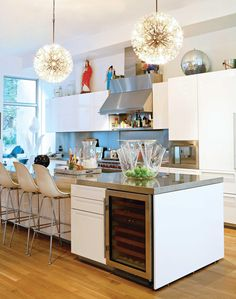 white sleek cabinets, concrete counters, barstools, concrete floors...done. Not these, but 2 lamp fixtures over the bar.
