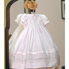 $57.99-$65.00 Baby Beautiful cotton Angels Garment baptismal special occasion dress will become a treasure item for years to come for both you and your little girl.  Stately and simple gown features lace detailed trim.  Dress has puffed gathered short sleeves which gives way to perfect added feminine charm for this most special occasion.  Headband is not included.