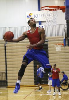 Kansas sophomore Wayne Selden skies for his dunk while campers applaud his style on Tuesday, June 10, 2014. #KU