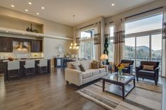 A space living room and an open concept kitchen in the Summit Residences by Domae Homes