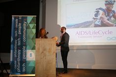 Sande Hart of Compassionate California presenting Compassion Week Award to AIDS/LifeCycle