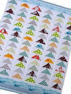 Traditional baby quilts don& have to be boring! The Silly Goose Baby Quilt improves on flying geese quilt patterns with fun print fabrics and a whale print border. The geometric shapes and prints are especially good for baby boy quilts. Quilt Baby, Baby Boy Quilt Patterns, Block Patterns, Quilt Inspiration, Flying Geese Quilt, Quilting Projects, Quilting Ideas, Quilting Designs, Scrappy Quilts