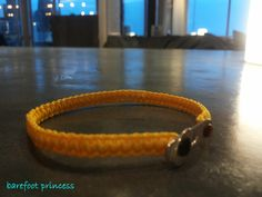"""moody skipper"" bracelet in yellow silk cord & silver 925 clasp"