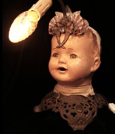 Bohemian steampunk lamp - Vintage doll head mounted to antique brass lamp base with a little seashell and crystal headpiece. By Victorian Voodoo. Find her on Etsy!