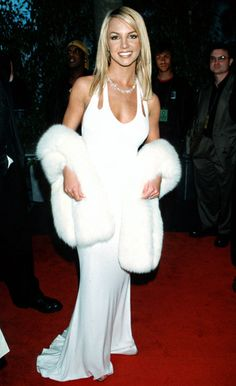 Britney Spears went for a sophisticated white Randolph Duke gown with a glamorous Oscar de la Renta fur wrap in 2001.