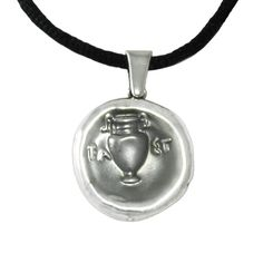 From the ancient coin of Thebes, with the design of the shield on the one side, we have created for you a special two-sided silver pendant which can be worn each time from a different side. Every time a new look.  Boeotian League coin  Diameter: 2.5 cm  Silver 999ο