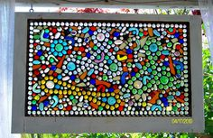 I made this by adding glass flat back marbles to an old recycled window. Just glued them onto the original window.