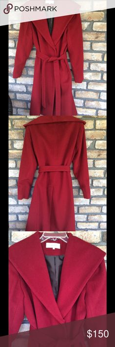 Red Full Length Wool Coat This is a Great Quality Coat. Full length Soft Wool Coat. Has a wide collar for a stylish appearance. Front pockets. A Slit in the back for easy movement. Snap Closure with a belt. Coat is in Excellent condition. The only issue I see one of the belt loops is missing. But an easy fix. Replace the loop or tack belt to Coat. A great find!! Exterior is 60% Wool 25% Polyester 10% Rayon 5% other Calvin Klein Jackets & Coats