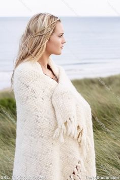 People wrapped in warm blankets   Young Woman Standing In Sand Dunes Wrapped In Blanket Stock Photo ...