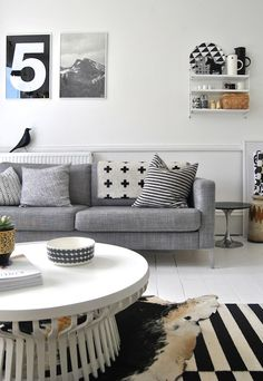 ikea couch in isunda grey cowhide rug...look a the legs of the sofa.  Maybe not so bad.  How will they look on the footstool?