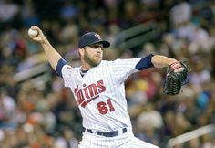 Jun 30, 2014; Minneapolis, MN, USA; Minnesota Twins relief pitcher Jared Burton (61) pitches in the eighth inning against the Kansas City Royals at Target Field. The Kansas City Royals win 6-1. Mandatory Credit: Brad Rempel-USA TODAY Sports
