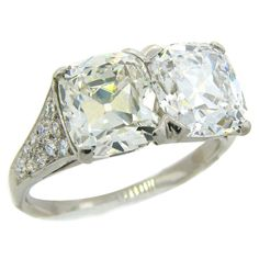 Cartier Art Deco Diamond Platinum Two Stone Ring | From a unique collection of vintage cocktail-rings at https://www.1stdibs.com/jewelry/rings/cocktail-rings/
