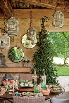 outdoor dining area, decorated with lanterns from Vietnam, is under a covered terrace.