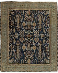 This circa-1920 antique Persian Kirman rug features an intricate all-over design of floral abstractions and arabesques, palmettes and serrated leaves in shades of rust, beige and a light blue that matches its main border, against a field of midnight blue.