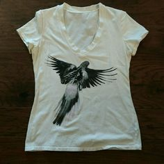 """Norma Kamali graphic tee A grey, black and pink parakeet adorn this awesome tee. Worn a few times. In excellent condition. The chest measurement is 36"""". Norma Kamali Tops Tees - Short Sleeve"""