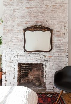 There's no denying that exposed brick walls always command attention. But what if you want to further enhance your beautiful brick? We've got wall decor ideas to help your enviable architectural detail command even more attention. Brick Wall Bedroom, Brick Wall Decor, Brick Wall Paneling, Tv Wall Decor, White Brick Walls, Exposed Brick Walls, Bedroom Fireplace, Brick Fireplace, Whitewashed Brick