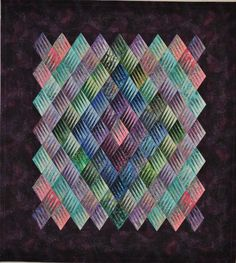 """Diamonds are a Girl's Best Friend"", made with 110 paper-pieced diamond blocks. Color placement of the blocks forms a secondary diamond pattern within the quilt.  2011 Opportunity Quilt, Quilters Unlimited (Florida)."