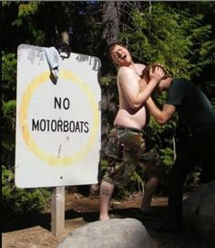 """Two Guys Flagrantly Ignore """"No Motorboating"""" Sign. Look at these badasses breaking the rules."""