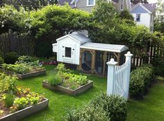 Garden with chicken coop. This once empty yard was transformed with perennial gardens, raised garden beds, a cute chicken coop, and boxwood hedge with a garden gate. The raised beds are Cute Chicken Coops, Backyard Chicken Coops, Chickens Backyard, Backyard Plants, Backyard Ideas, Chicken Feeders, Backyard Farming, Farmhouse Landscaping, Farmhouse Garden