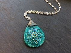 This Listing is for a Silver wire wraped Resin Opal necklace with Lotus flower design. The necklace is available in Rubi red or green opaque. The lenght of this necklace is customizable and it will ar
